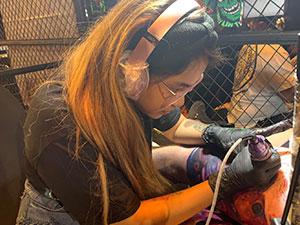 tattoo artist doing work